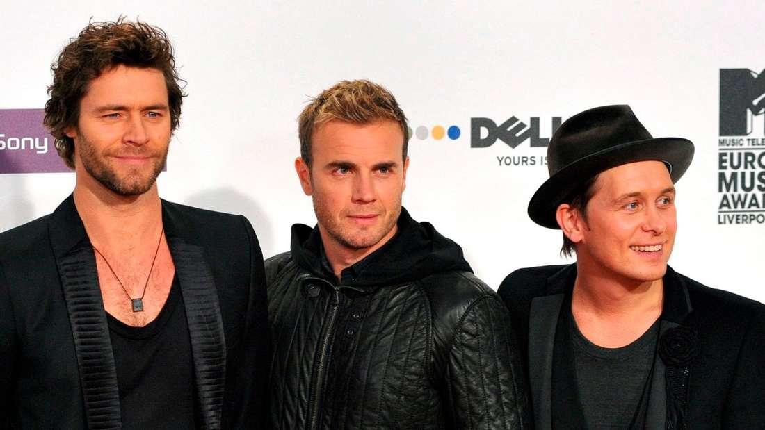 """Nach den Steuervorwürfen gegen die Sänger der Gruppe Take That wird Gary Barlow (M.) aufgefordertm seine Ehrung """"Order of the British Empire"""" (OBE) zurückzugeben"""