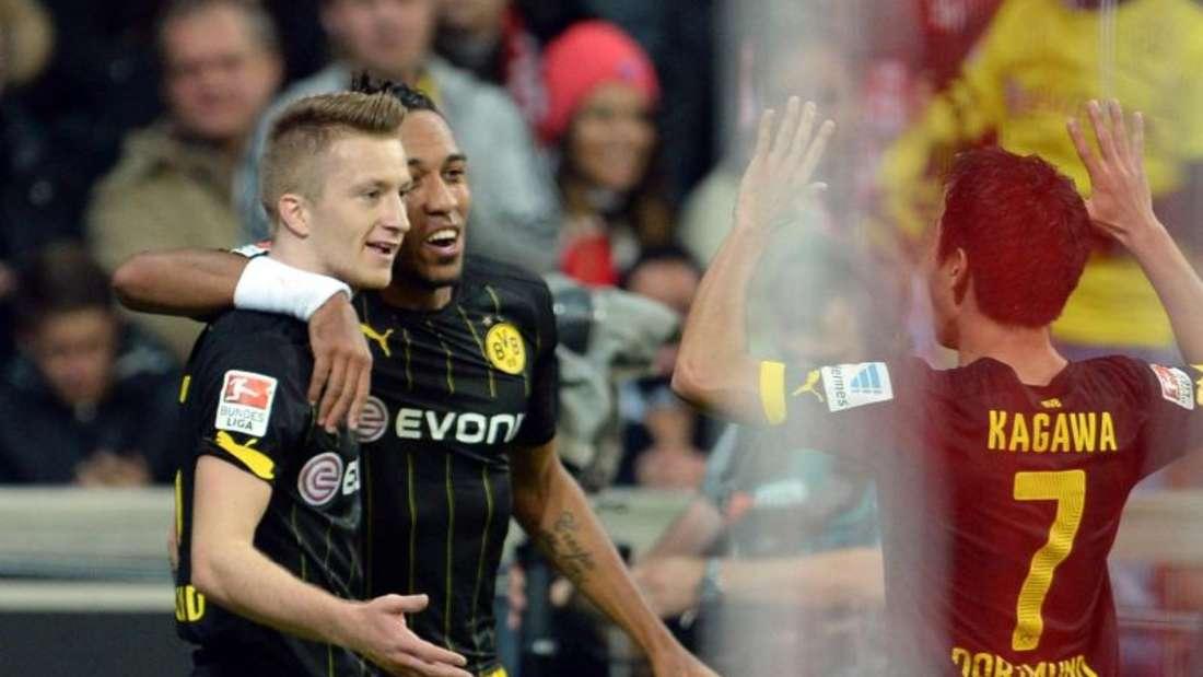 Marco Reus (l) köpfte den BVB in der 31. Minute mit 1:0 in Führung. Foto: Andreas Gebert