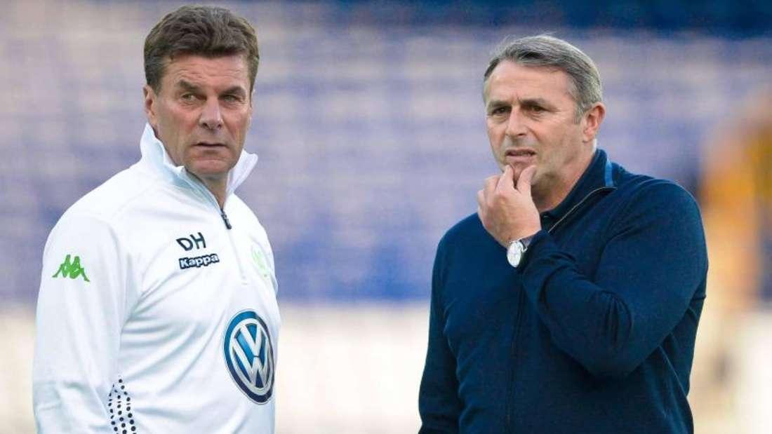 VfL-Coach Dieter Hecking (l)und Manager Klaus Allofs sorgen sich um viele Ausfälle. Foto:Peter Steffen
