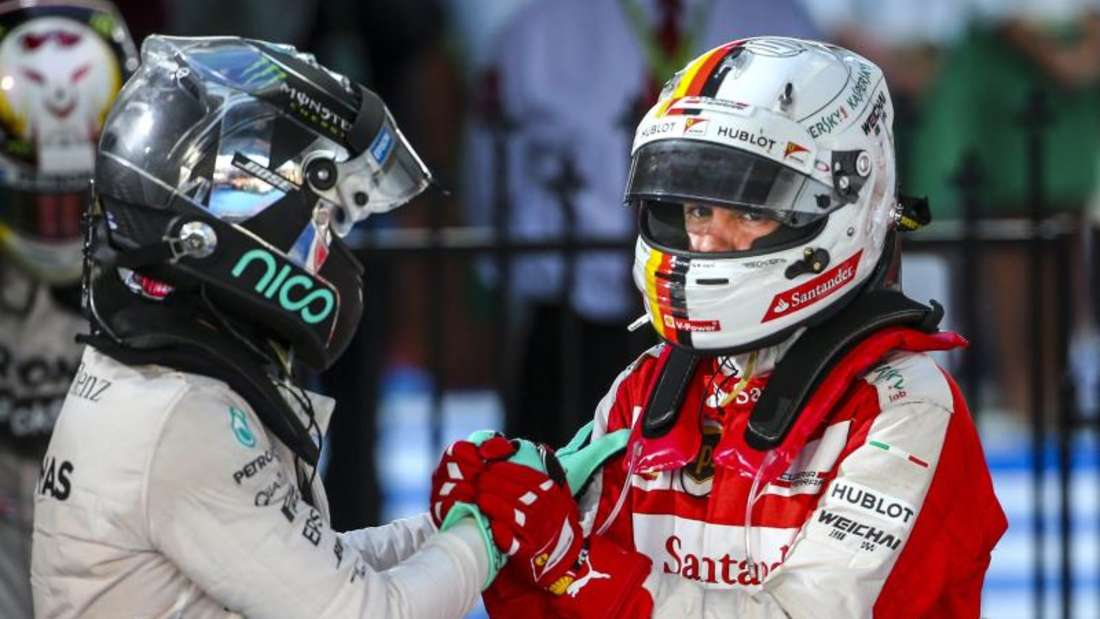 Nico Rosberg hat Landsmann Sebastian Vettel in die Mercedes-Box eingeladen. Foto: Diego Azubel