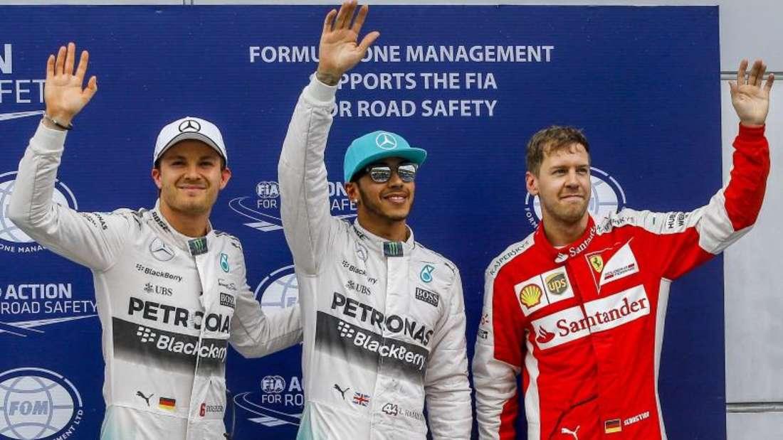 Sebastian Vettel und Nico Rosberg jagen den Briten Lewis Hamilton. Foto: Azhar Rahim