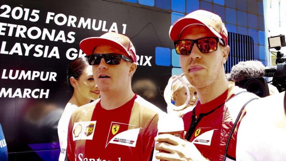 Kimi Räikkönen (l) und Sebastian Vettel kommen gut miteinander aus. Foto: Diego Azubel