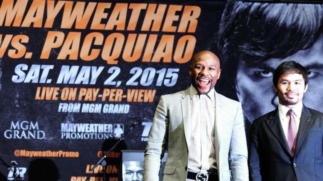 Floyd Mayweather (l) kämpft gegen Manny Pacquiao. Foto: Jonathan Alcorn