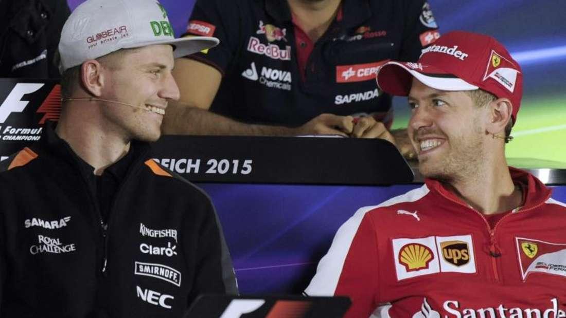 Force-India-Pilot Nico Hülkenberg und Sebastian Vettel von Ferrari. Foto: Hans Klaus Techt