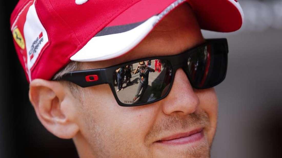 Sebastian Vettel betont die Gemeinsamkeit mit dem Team der Scuderia. Foto: Olivier Hoslet