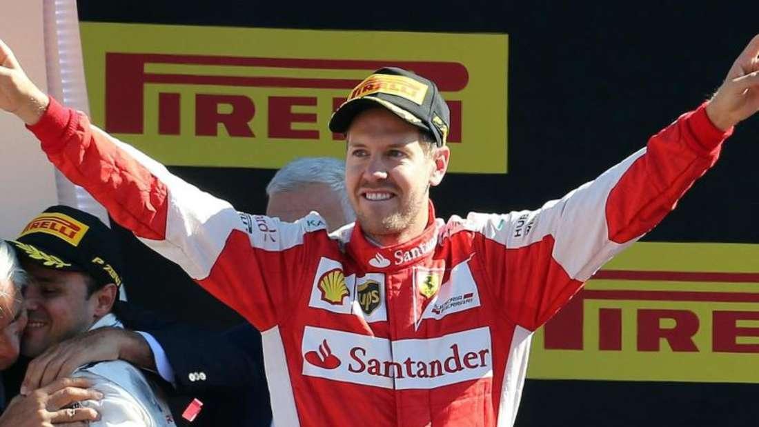 Sebastian Vettel feiert seinen zweiten Platz beim Grand Prix von Italien. Foto: Daniel Dal Zennaro