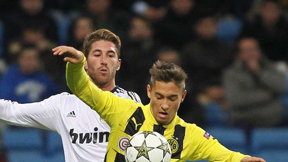 Moritz Leitner (r.) kämpft gegen Real Madrids Sergio Ramos um den Ball in der Champions-League-Partie Real Madrid - Borussia Dortmund am 06.11.2012.