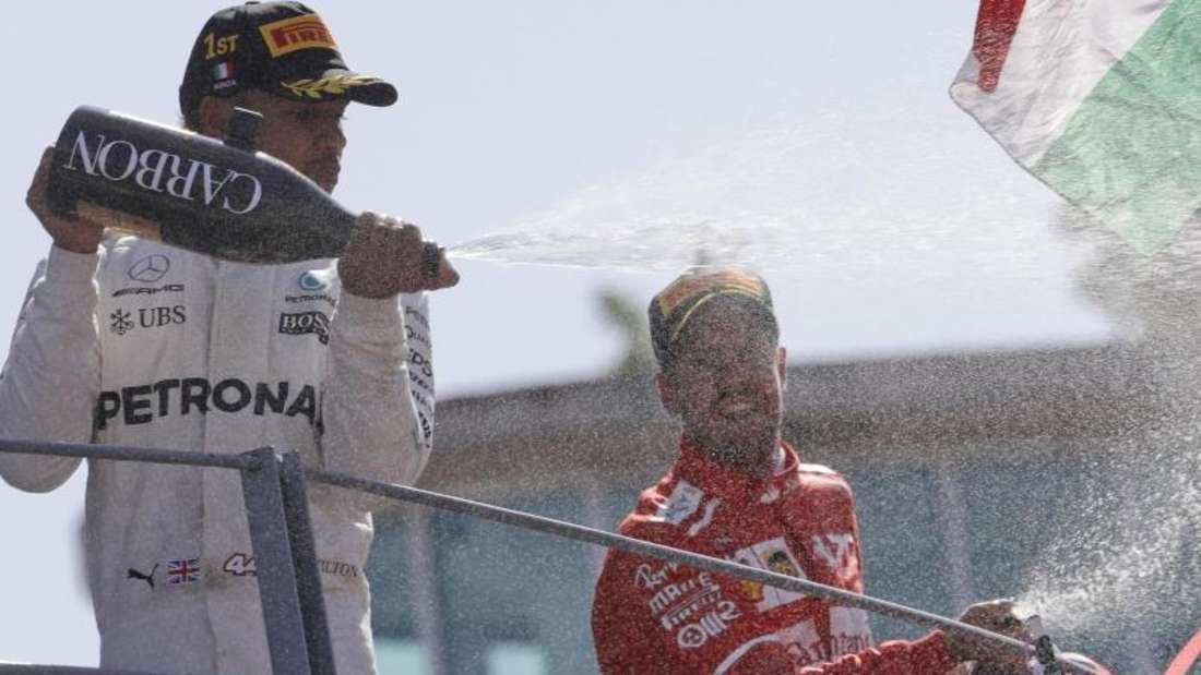 Lewis Hamilton (l) gewann den Großen Preis von Italien, Sebastian Vettel wurde Dritter. Foto: Luca Bruno