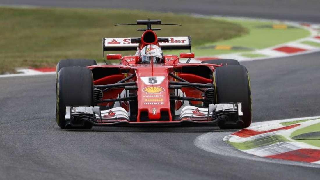 Ferrari-Fahrer Sebastian Vettel freut sich auf den Grand Prix in Singapur. Foto: Antonio Calanni