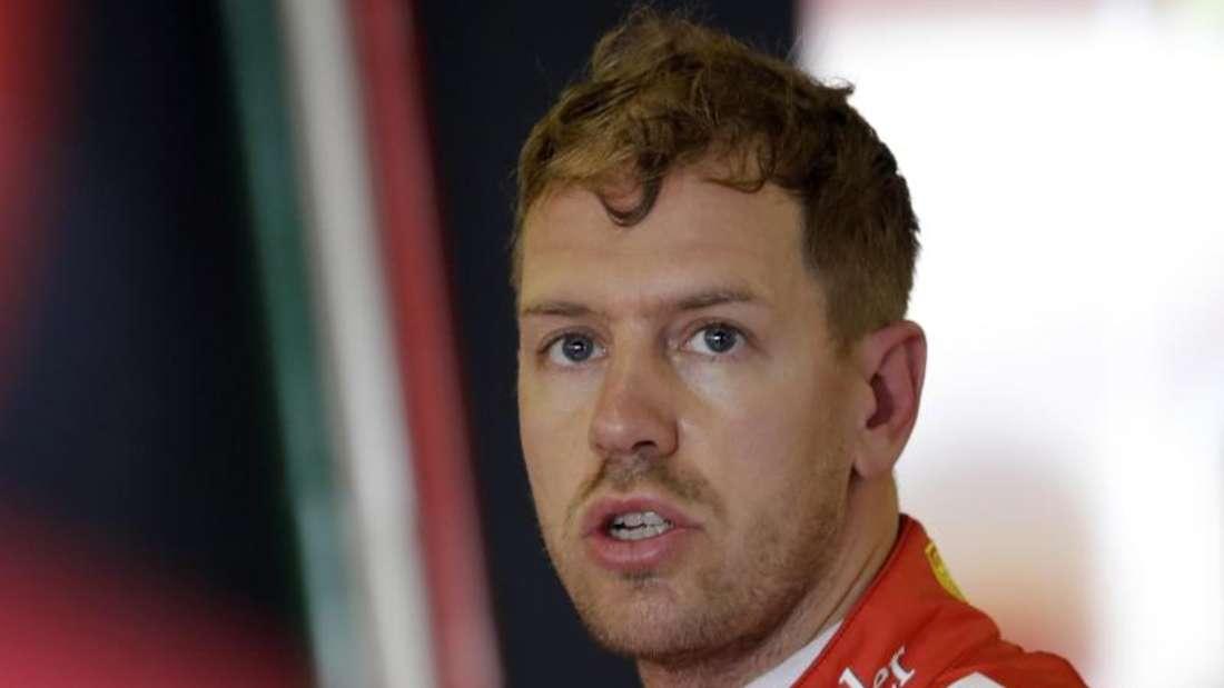 Sebastian Vettel hofft noch einmal auf perfekte Arbeit seiner Ferrari-Mechaniker. Foto: Luca Bruno