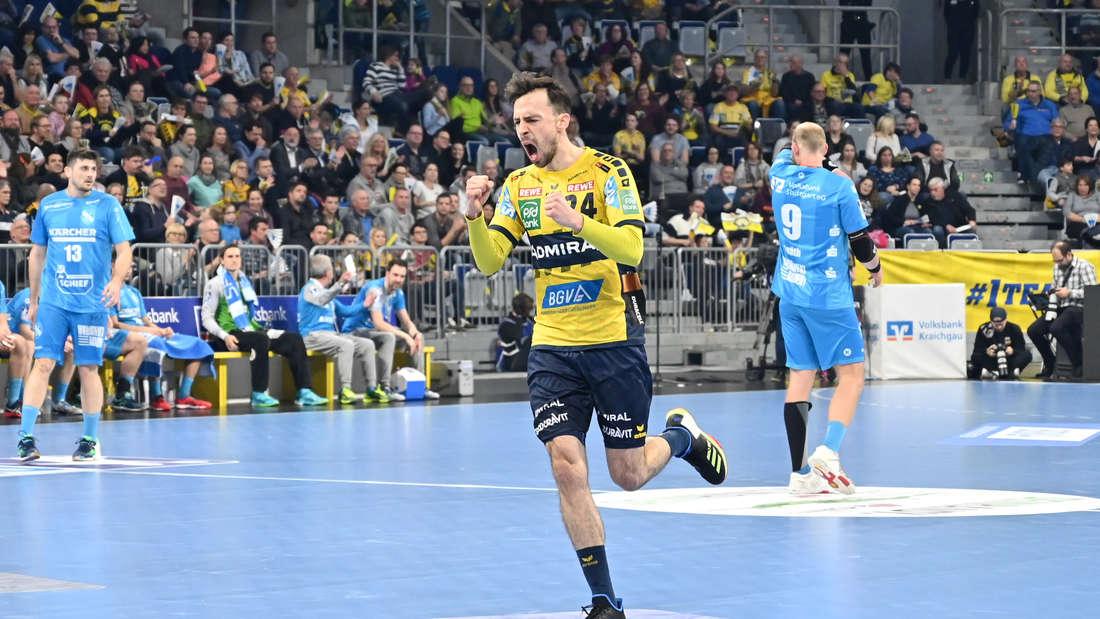 Patrick Groetzki jubelt über den Löwen-Sieg gegen den TVB Stuttgart.