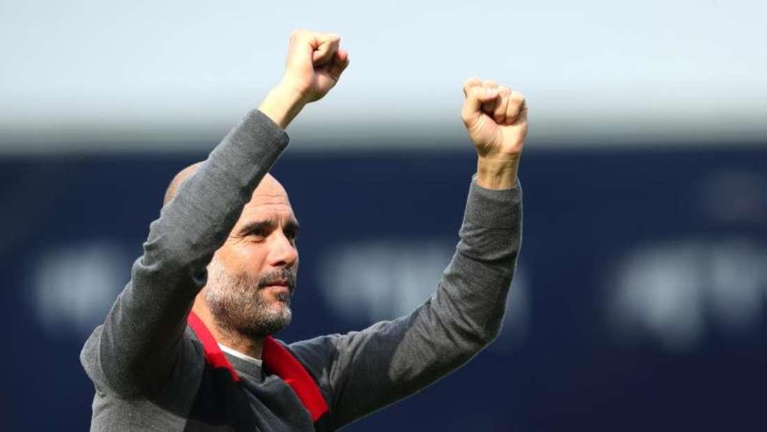 Manchester Citys Trainer Pep Guardiola jubelt über Sieg gegen Fulham. Foto: Jonathan Brady/PA Wire