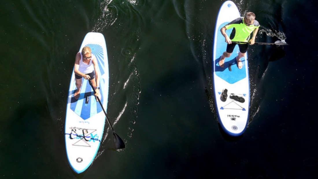 Stand-up-paddling, schwimmen oder einfach nur ein bisschen die Füße ins Wasser stellen - an manchen Seen nicht die beste Idee.