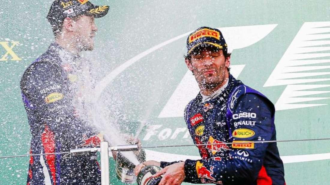 Fuhren einst bei Red Bull erfolgreich zusammen: Sebastian Vettel (l) und Mark Webber. Foto: Diego Azubel/EPA/dpa