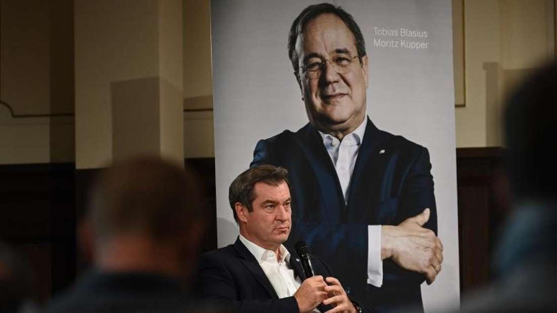 """Bayerns Ministerpräsident Markus Söder (CSU) stellt das Buch """"Der Machtmenschliche - Armin Laschet. Die Biografie"""" vor. Foto: Britta Pedersen/dpa-Zentralbild/dpa"""
