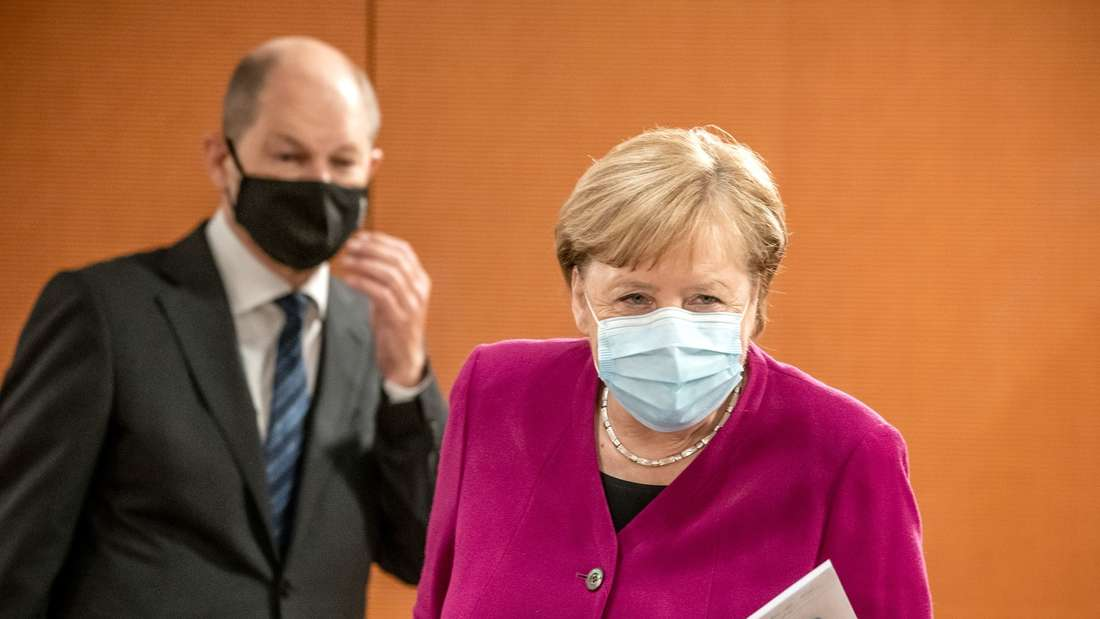 Angela Merkel und Olaf Scholz mit Masken bei einer Kabinettssitzung in Berlin