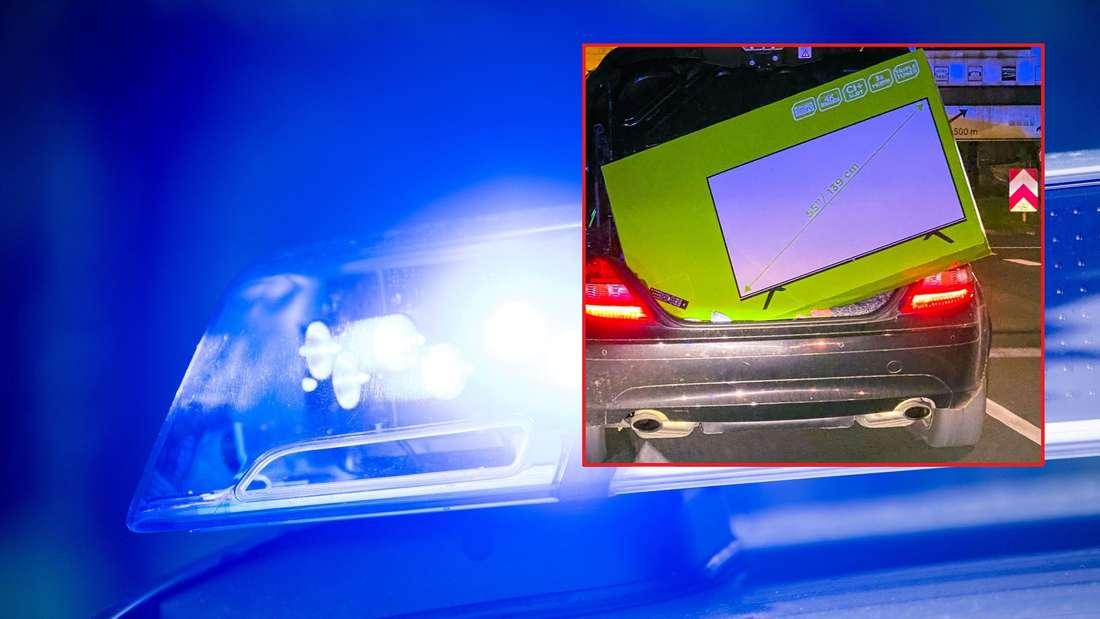 Ein Mercedes SLK ist mit einem riesigen Fernseher im Kofferraum völlig überladen.