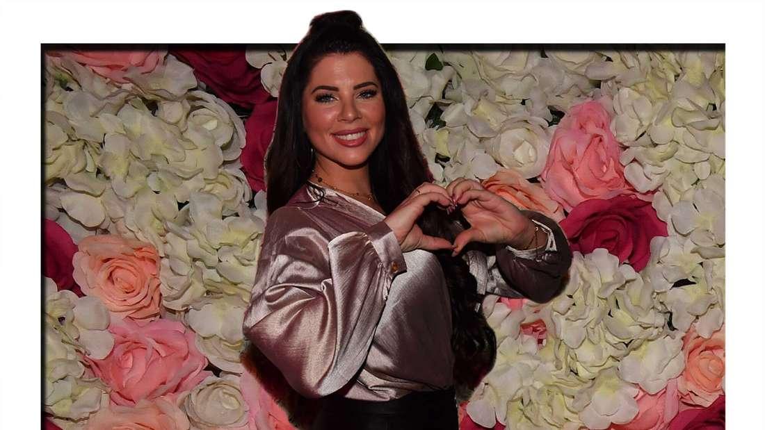 Fotomontage: Jenny Frankhauser macht ein Herzzeichen, im Hintergrund eine Wand aus Rosen