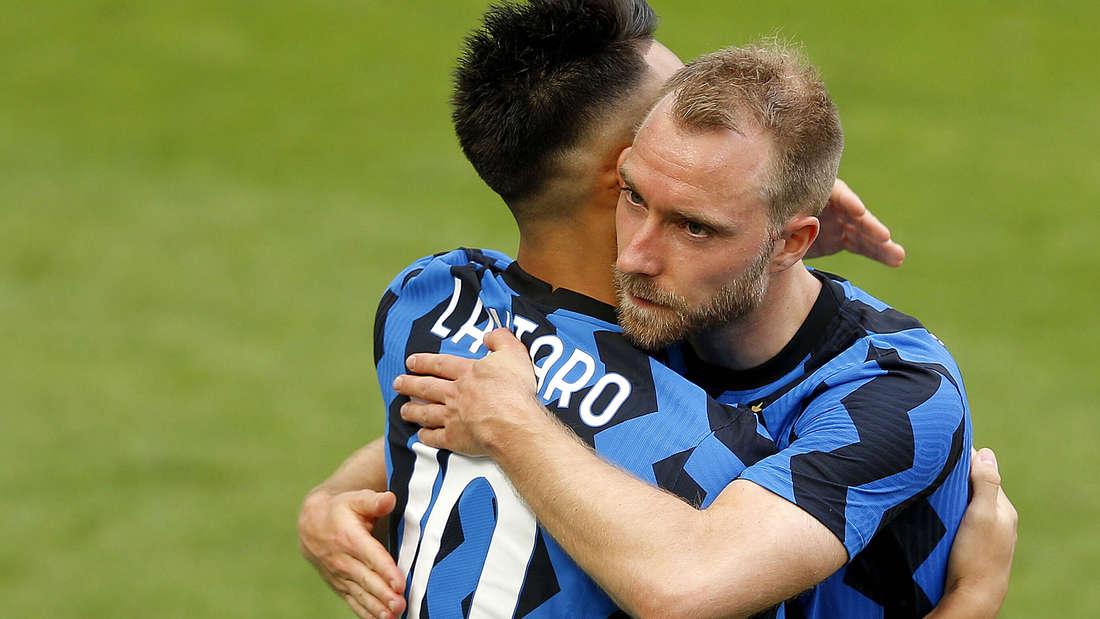 Lautaro Martinez and Christian Eriksen of FC Internazionale celebrate the victory of the italian championship